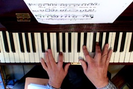 Fergus Black hands on piano from overhead camera