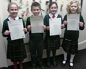 Proud children with exam certificates