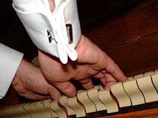 hands on an organ keyboard
