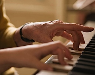 A pianist's hands on the keyboard